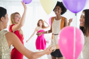 Women playing with balloons at party