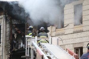 Fire fighters on the scene at a building explosion in Borough Park, Brooklyn on October 3rd, 2015