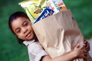 Child carrying groceries