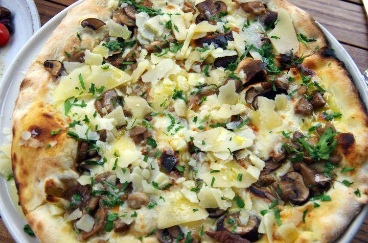 Funghi pizza with fior di latte (cow's milk mozzarella cheese), wild mushrooms, parmesan, truffle oil and fresh parsley
