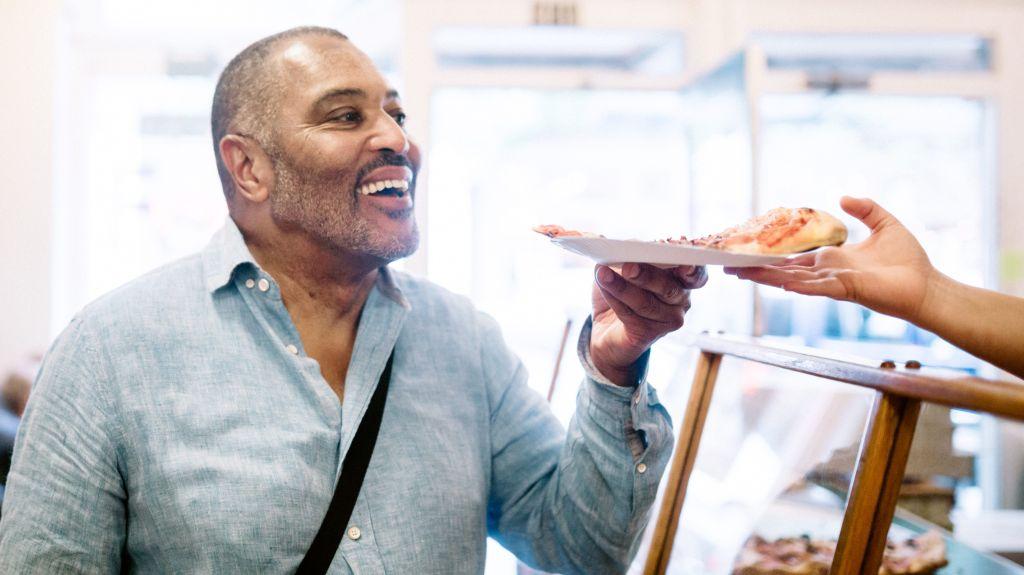 Mature Man Ordering Pizza Slice