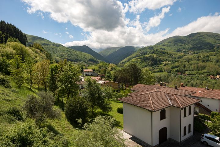Buildings and mountains close to Castelnuovo di Garfagnana in Lucca, Tuscany.