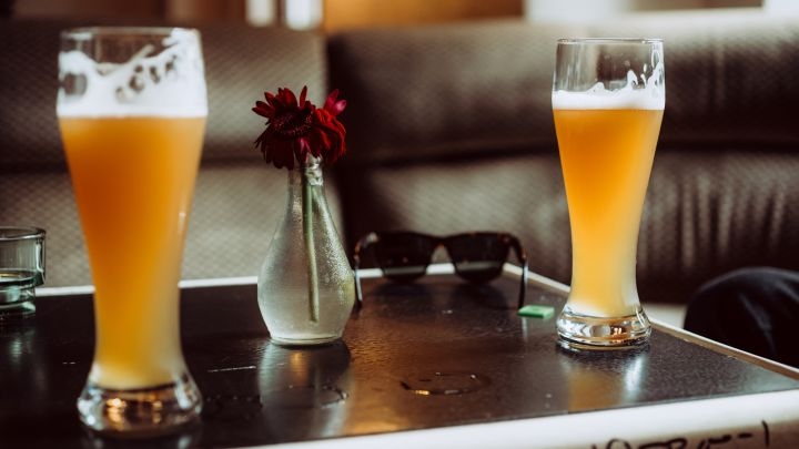 Close-Up Of Beer Glasses On Table At Restaurant