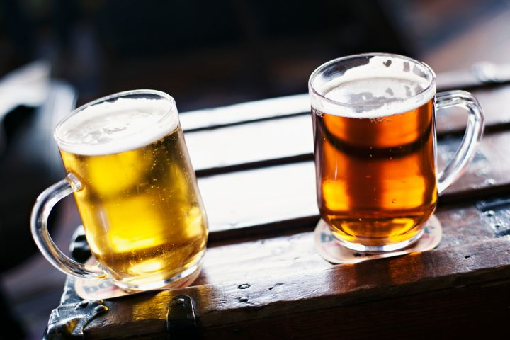 Two types of beer in tankards