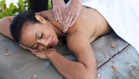 woman laying on massage table