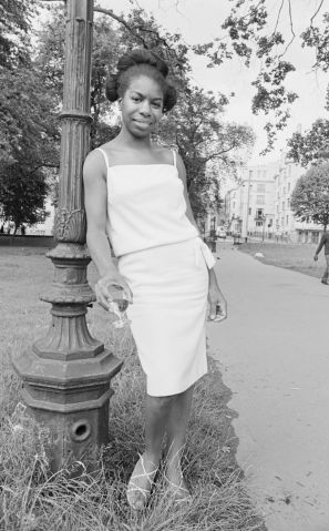Singer Nina Simone stands besides a lampost in Hyde Park before a press reception held at Philips record company buildin