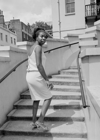 Singer Nina Simone stands on the steps of Philips record company building at Stanhope Place July 1965