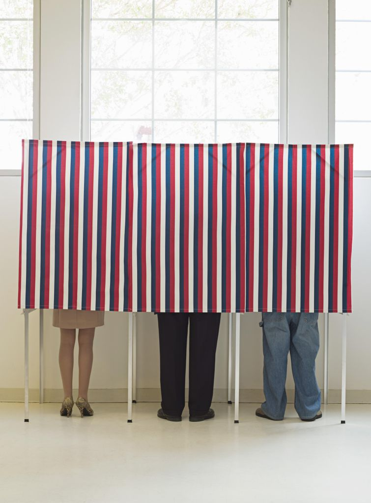 Voters in voting booths