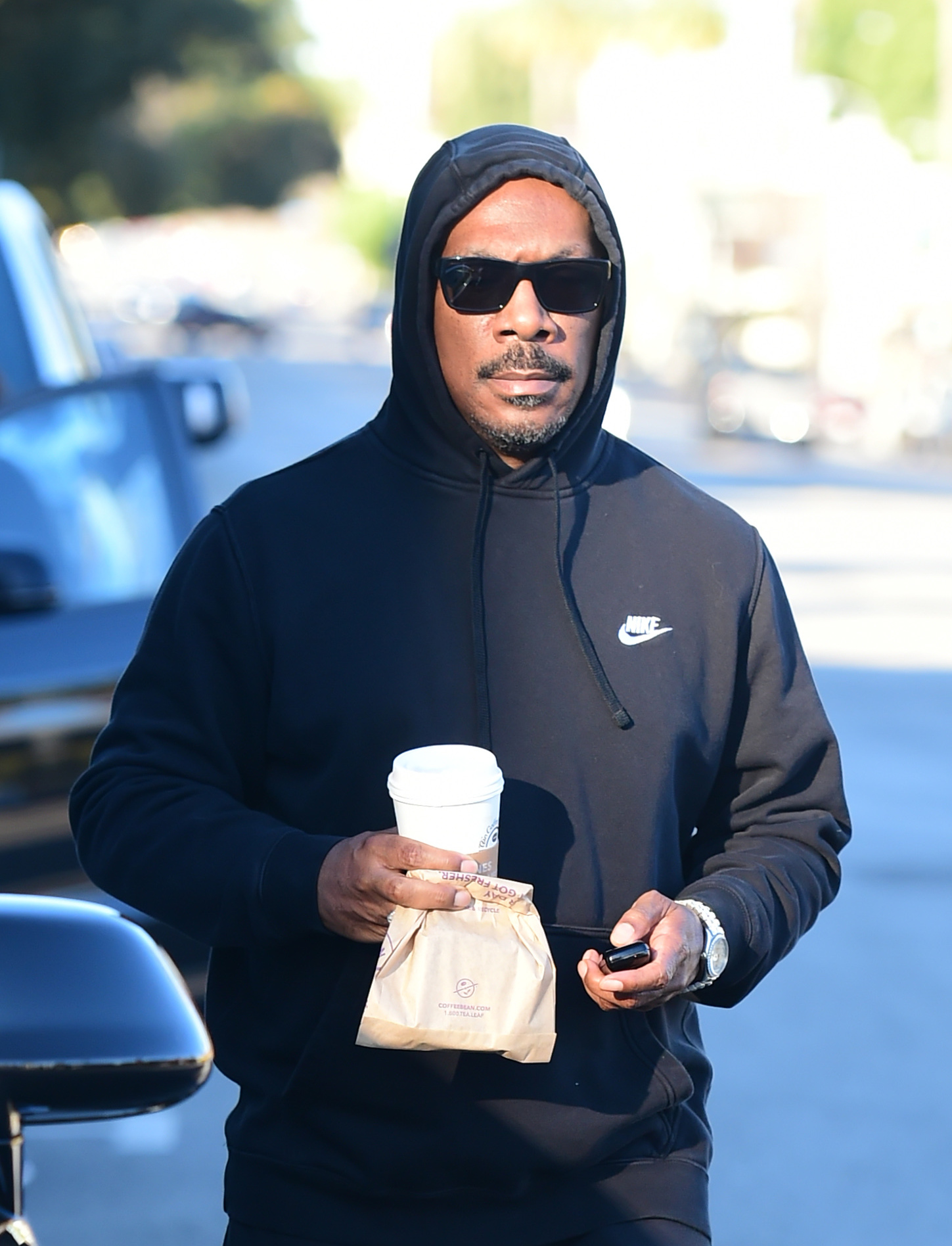 Eddie Murphy wears a Nike hoodie during an early morning coffee run